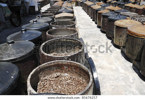 Fermenting soybean in rows of ferment pot at a traditional soya sauce factory in Kampung Malabar, Penang, Malaysia.
