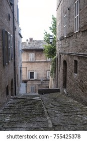 Fermo (Marches, Italy): historic buildings along an old typical alley at evening