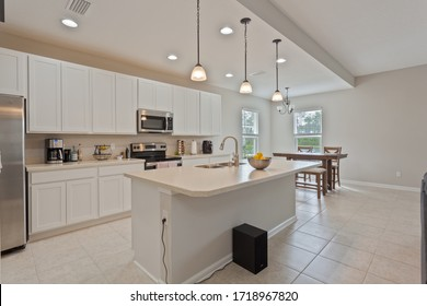 Fernandina Beach, Florida / USA - April 30 2020: Nice kitchen with white cabinets and stainless steel appliances