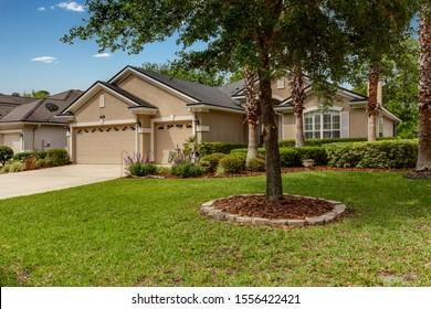 Fernandina Beach, Florida / USA - November 10 2019: Stucco home with garage