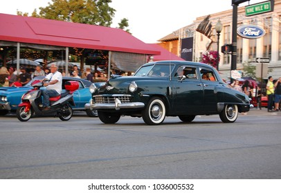 Ferndale, MI/USA- August 17 2013: Classic 1949 Studebaker Champion with white walls at the annual Woodward Avenue Dream Cruise vintage auto show event. Dark green black forties sedan restored car.