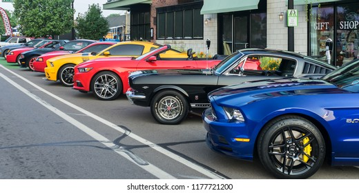 """FERNDALE, MI/USA - AUGUST 18, 2018: Nine Ford Mustang cars at """"Mustang Alley"""", at the Woodward Dream Cruise. Woodward is a National Scenic Byway."""