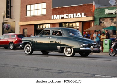 Ferndale, MI/USA-August 17 2013 Dark 1949 Studebaker Champion driving downtown at the annual Woodward Avenue Dream Cruise, near Detroit. Classic cars, white walls, chrome and crowds and fun abound!