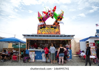 """Ferndale, Washington / USA - July 4 2019: Customers shopping for pyrotechnics at the""""Boom Boom Kaboom"""" firework stand in a rural roadside parking lot on the Fourth of July"""