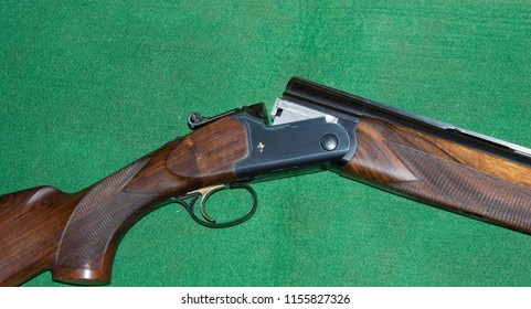 Ferney Voltaire, Rhone Alps France - June 2018: Hunting rifle FABARM Gamma Luxe Competition from Italy in the open state on green cloth. Close up.