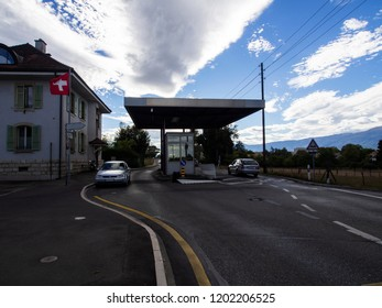 FERNEY-VOLTAIRE, FRANCE - Sept 22, 2018: Border point between France and Switzerland on the road between the cities of Ferney-Voltaire and Geneva