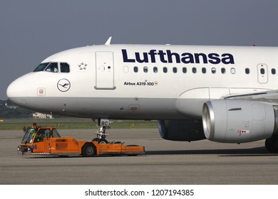 FERNO, ITALY - June 27, 2011: German Lufthansa Airbus A319-100 on pushback at Milan Malpensa Airport.