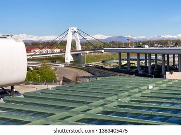 Ferno, Milan-Malpensa, Italy - April 8, 2019: View of the cable stayed bridge of Milan Malpensa International Airport.