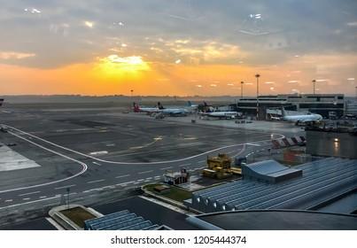 Ferno, Milan-Malpensa, Italy - October 10, 2018: View of Milan-Malpensa International Airport Terminal 1 at Sunries.