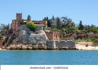 FERRAGUDO, PORTUGAL- July 27th, 2018: São João de Arade Fortress between the beaches of Praia Angrinha and Grande.