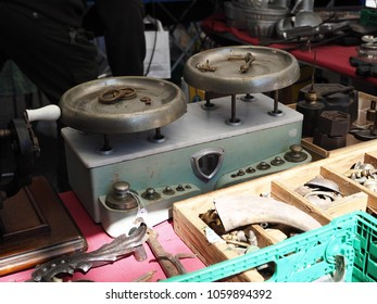 Ferrara, Italy - April 1, 2018. Antiques market in the historic center. Old scales.