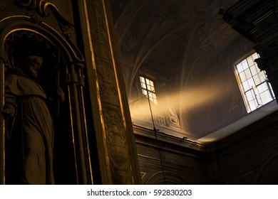 """Ferrara, Italy - April 29, 2016: Ray of light enters through a window of the Cathedral of San Giorgio in Ferrara. Ferrara is also known as the """"city of bicycles""""."""