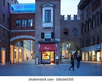 Ferrara, Italy - April 3, 2018. Historic centre, italian ice cream shop in the ancient tower.