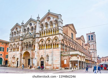FERRARA, ITALY - APRIL 30, 2013: One of the most beautiful building of the city is the Ferrara Cathedral with its carved marble frontage and loggias on the side, on April 30 in Ferrara