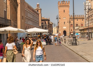 FERRARA, ITALY - AUGUST 24, 2018: Tourists and locals have fun shopping in the weekly market
