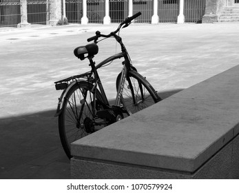 Ferrara, Italy - Avril 14, 2018. Piazzetta Sant'Anna in the historic center, a parked bicycle. Early afternoon of a spring Saturday. Black and white photo.
