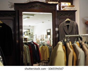 Ferrara, Italy - Avril 7, 2018. Shop of things used in the historic center. Second hand clothes displayed for sale and a big mirror.