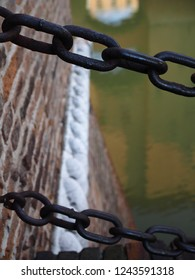 Ferrara, Italy. Este Castle, detail.  Chains at the entrance. You can see the water in the ditch.