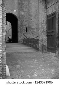Ferrara, Italy. Este Castle, detail. The entrance and the bridge. Black and white photo.
