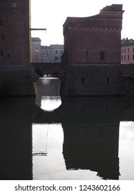 Ferrara, Italy. Este Castle, detail. The castle reflected in the moat.