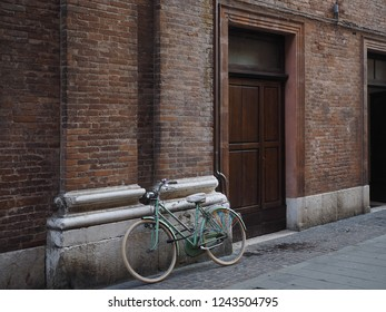 Ferrara, Italy. Italian street, facade, door and bike.