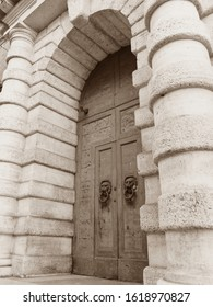Ferrara, Italy - January 11, 2020. Door of Palazzo Contughi Gulinelli. The palace was built in 1542 by the will of the notable Girolamo Mario Contughi. Sepia photo.