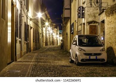 Ferrara, Italy - July, 23, 2018: cars parked in Ferrara, Italy, at night