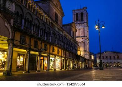 Ferrara, Italy - July, 23, 2018: street in the historical center of Ferrara at a night