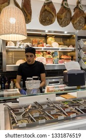 Ferrara, Italy - June 10, 2017: Inside small Italian food and mini market with  staff at work in Ferrara. Italy