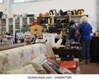 Ferrara, Italy - June 17, 2019. Flea market. Miscellaneous goods displayed for sale.
