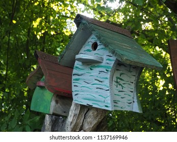 Ferrara, Italy - June 20, 2018. Colored wooden cottages for birds.