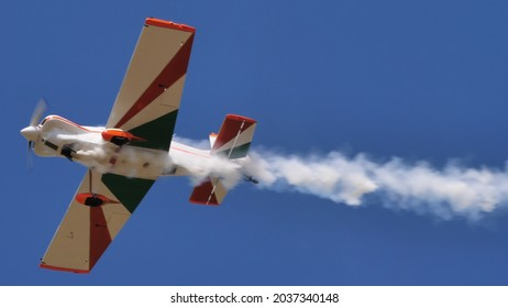 Ferrara Italy JUNE, 27, 2021 Close view of a small propeller plane in flight with the Italian flag painted on the wings. Corby CJ-1 Starlet single seat, amateur built airplane of the 1960s
