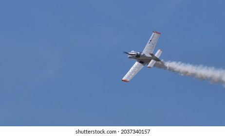 Ferrara Italy JUNE, 27, 2021 Home built light airplane in flight with white smoke. Corby CJ-1 Starlet single seat, amateur built airplane of the 1960s