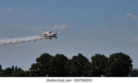 Ferrara Italy JUNE, 27, 2021 White plane high speed low altitude pass just above the treetops. Corby CJ-1 Starlet single seat, amateur built airplane of the 1960s