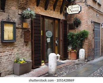 Ferrara, Italy - March 17, 2018.  Facade of an ancient Italian tavern in the historic center.