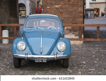 FERRARA / ITALY - MARCH 25, 2017: A vintage Volkswagen beetle with a pair of wooden skis on the rack. This car was built in 1961.