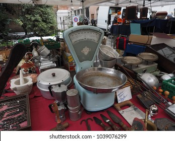 Ferrara, Italy - March 4, 2018. Flea market. Stall with old scales and objects for the kitchen.