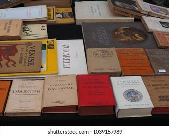 Ferrara, Italy - March 4, 2018. Flea market. Old italian books for sale.