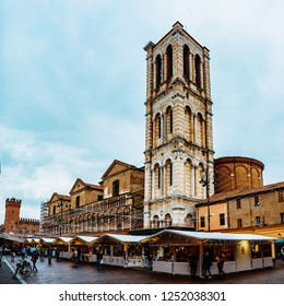 FERRARA, ITALY - NOVEMBER 25 2016: marketplace near Bell tower of Cathedral (Basilica Cattedrale di San Giorgio, Duomo) is Roman Catholic cathedral and minor basilica in Ferrara, Italy.