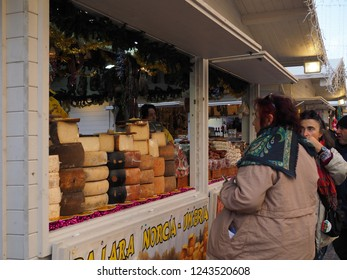 Ferrara, Italy - November 26, 2018. Christmas market in the main square.  Cheese stand.