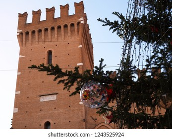 Ferrara, Italy - November 26, 2018. Torre della Vittoria with Christmas tree.