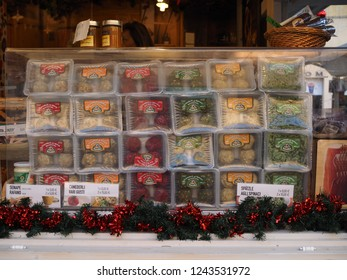 Ferrara, Italy - November 26, 2018. Christmas market in the main square. Assorted Knödel on sale.