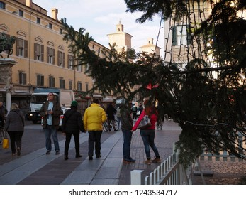 Ferrara, Italy - November 26, 2018.  Piazza del Duomo, Christmas tree and tourists strolling.
