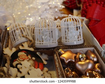 Ferrara, Italy - November 26, 2018.  Christmas tree balls for sale at a flea market. There are angels inside small birdcages.