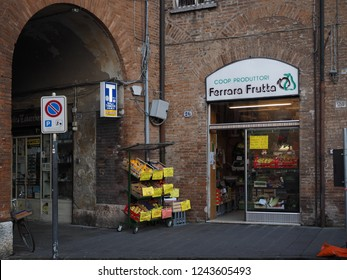 Ferrara, Italy - November 26, 2018.  Tobacco shop next to fruit shop, two ways of life.