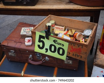 Ferrara, Italy - November 4, 2017. Flea market in the main square. Old small metal boxes of candy and medicine, each empty box costs 5 euros.