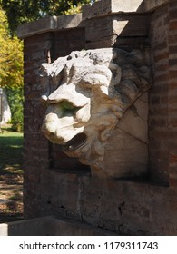 Ferrara, Italy. Parco Massari, the main public park of the town. Fountain with a lion's head.