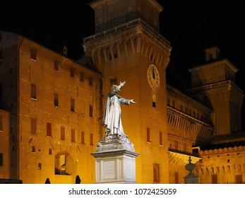 Ferrara, Italy. Pizza Savonarola, Savonarola statue and Este castle by night.