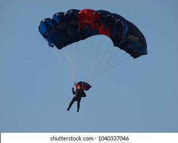 Ferrara, Italy - September 11, 2011. Balloons Festival, italian paratrooper carabiniere. Parachute jump.