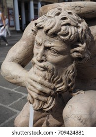 Ferrara, Italy - September 2, 2017. Garage sale, ancient garden statue. Man with a beard.
